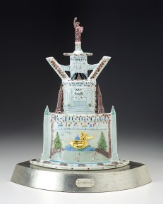 "Mara Superior, ""My New York"", 2004, 18 x 15 x 9"", high-fired porcelain, ceramic oxides, underglaze, glaze, white gold leaf, bone, ink, brass pins. Currier Museum of Art (2019.9a-c)."