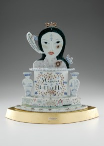 "Mara Superior, ""Madama Butterfly"", 2005, 22 x 18 x 8"", high-fired porcelain, ceramic oxides, underglaze, glaze, wood, gold leaf, bone, brass pins."