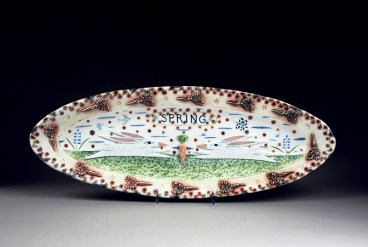 """Mara Superior, """"Spring Two Rabbits Relief"""", 2002, 19.5 x 6.5"""", high-fired porcelain, ceramic oxides, underglaze, glaze."""
