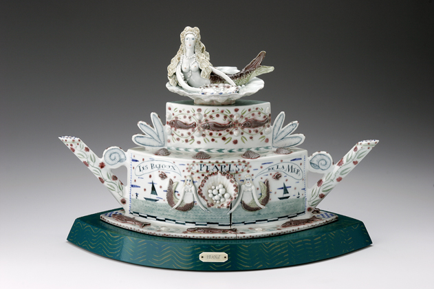 "Mara Superior, ""Bijoux Pearls"", 2006, high-fired porcelain, ceramic oxides, underglaze, glaze, wood, paint, bone, brass pins, 16 x 20.5 x 12"". New Britain Museum of American Art Collection."