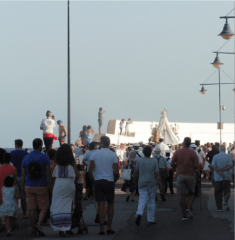 A small gathering of fishing folk followed the brass band with drums a-booming and trumpets a-blaring as they escorted the Virgen del Carmen´s throne bearers to the docking area just past the Fish Market.