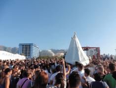 The celebrants cheered as the Virgin was brought back to her stage on the beach.