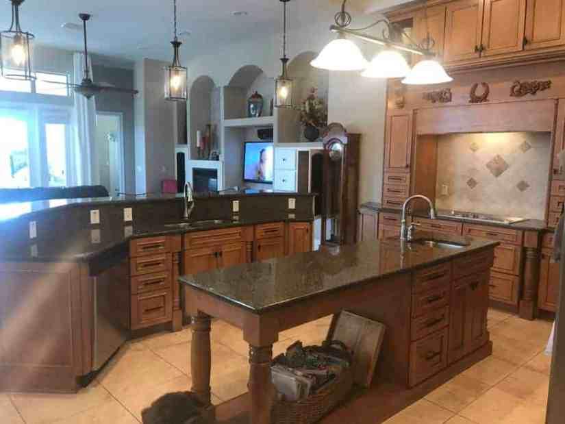 Kitchen with 2 islands overlooking living room