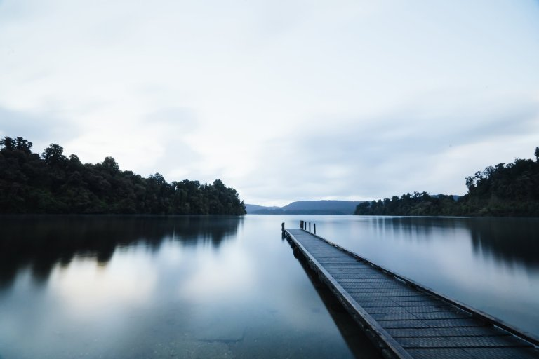 negative-space-long-dock-through-calm-lake