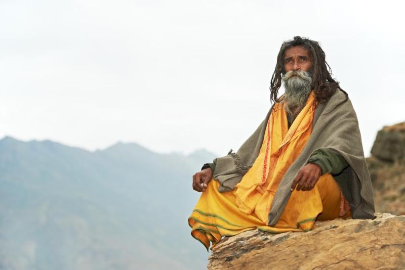 a guru on a rock