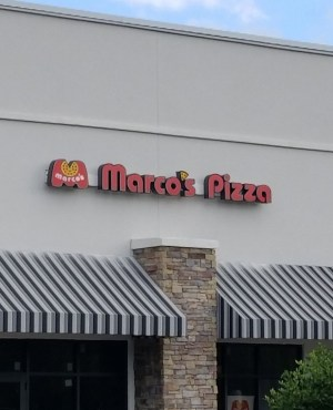 A view of the awnings and sign on the front of the Marco's Pizza location in Apopka, FL.