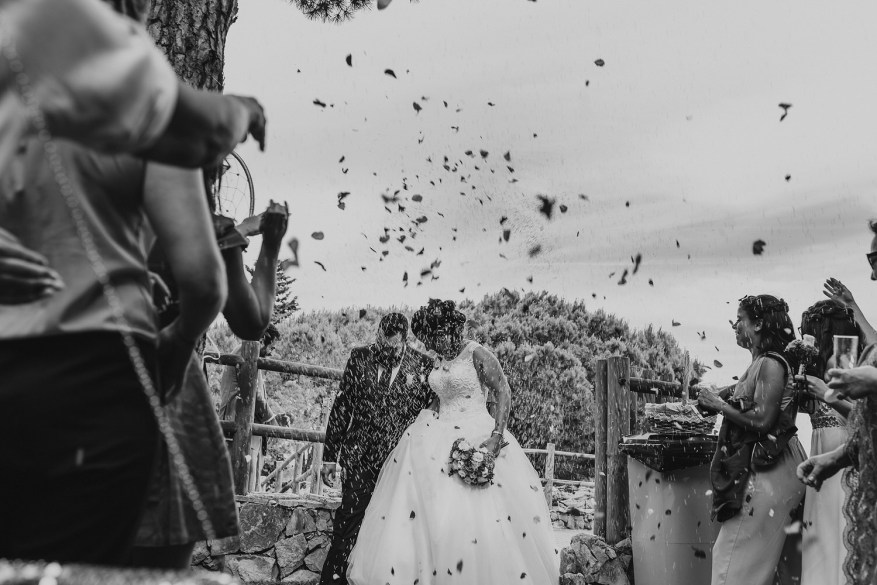 rice and petals thrown at the wedding couple