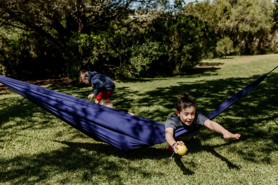 kids playing in a hammock on a destination wedding in Portugal