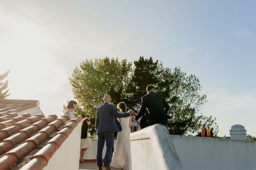 gorgeous photo of the groom and guests at their destination wedding
