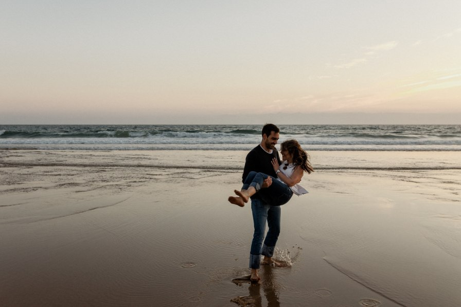future wife being carried on her boyfriends arms at a engagement session