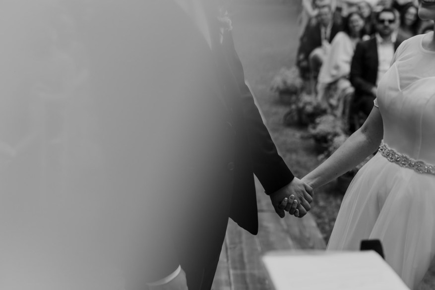 bride and groom hold hands during their destination wedding in Portugal