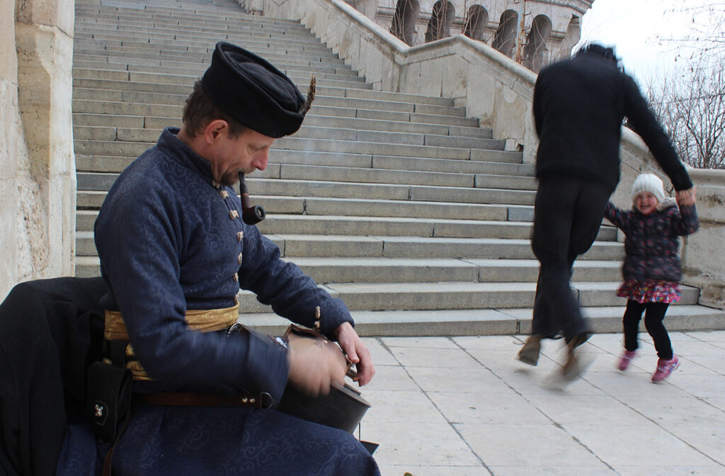 Artist plays a typical Hungarian instrument