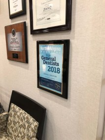 marcus dental waiting room wall with awards and certifications - Tour The Office