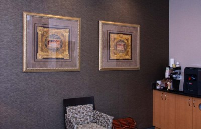 marcus dental waiting room wall with paintings - Tour The Office