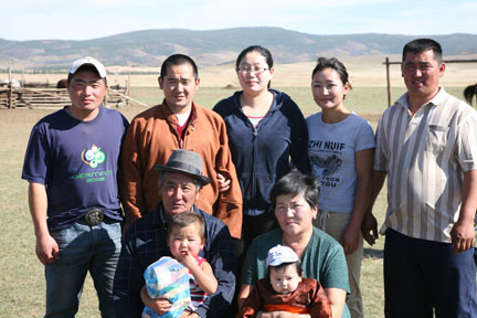 Buka (second from left) and family
