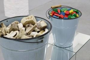 Marcus Kleinfeld, REALISATION (Detail), 2014 2 buckets, bones, toy bricks, mirrored plinth 100 x 90 x 30 cm