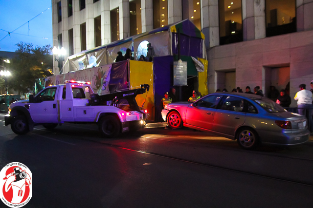 This tow truck backed in, latched onto the car, and was away within 60 seconds and the driver never left the truck