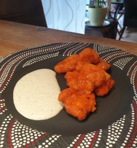 Buffalo chicken bites with homemade buffalo sauce and chunky blue cheese dressing