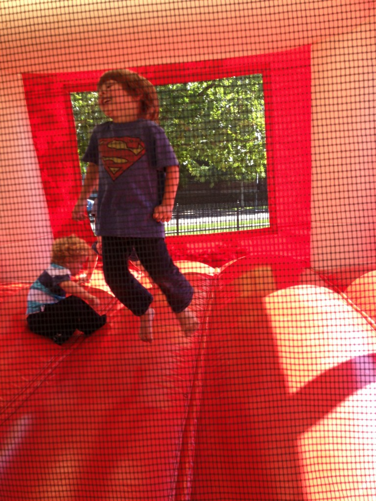 child in bounce house