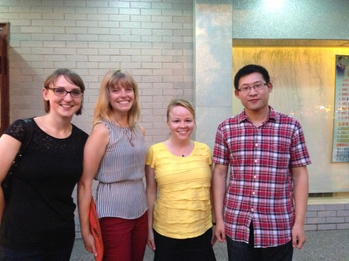 Erin, Jenna, Margaret, and Yunfei at dinner in Wuhan, China.