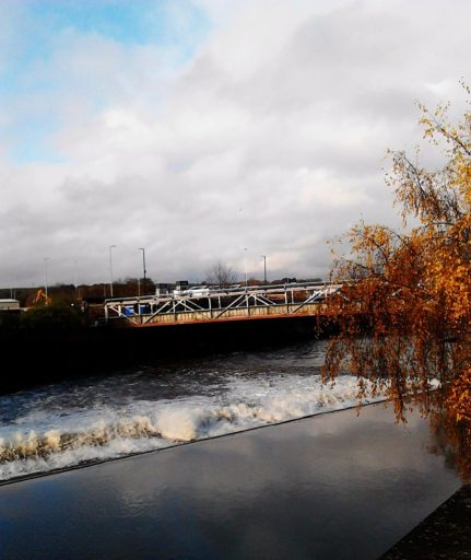 A photo of the River Don in full flow after the floods,  taken in the town centre