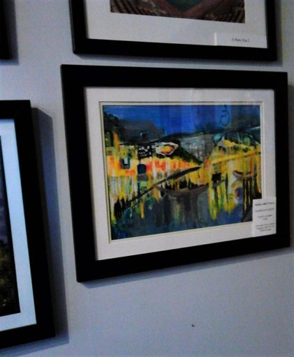 My acrylic painting  Harbour Lights  on the wall in the art cafe.A coastal landscape