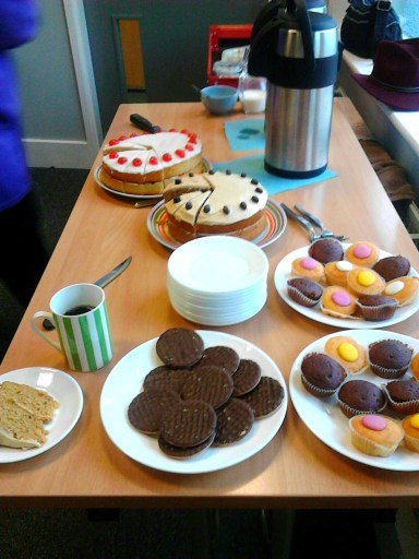 A photo of plates of biscuits and delicious homemade cakes