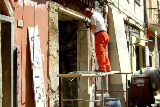 Workers making repairs in flood damaged Vernazza