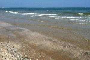 Beach Scene in Rimini Photo by Margie Miklas