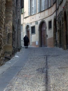 Italian woman walking uphill in Bergamo Photo by Margie Miklas