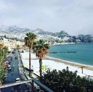 Snow in Giardini Naxos, Sicily Photo by @Sicilyconcierge