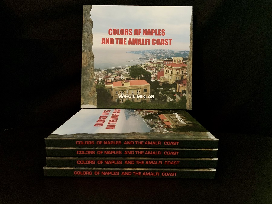 Colors of Naples and the Amalfi Coast books on side Photo by Margie Miklas