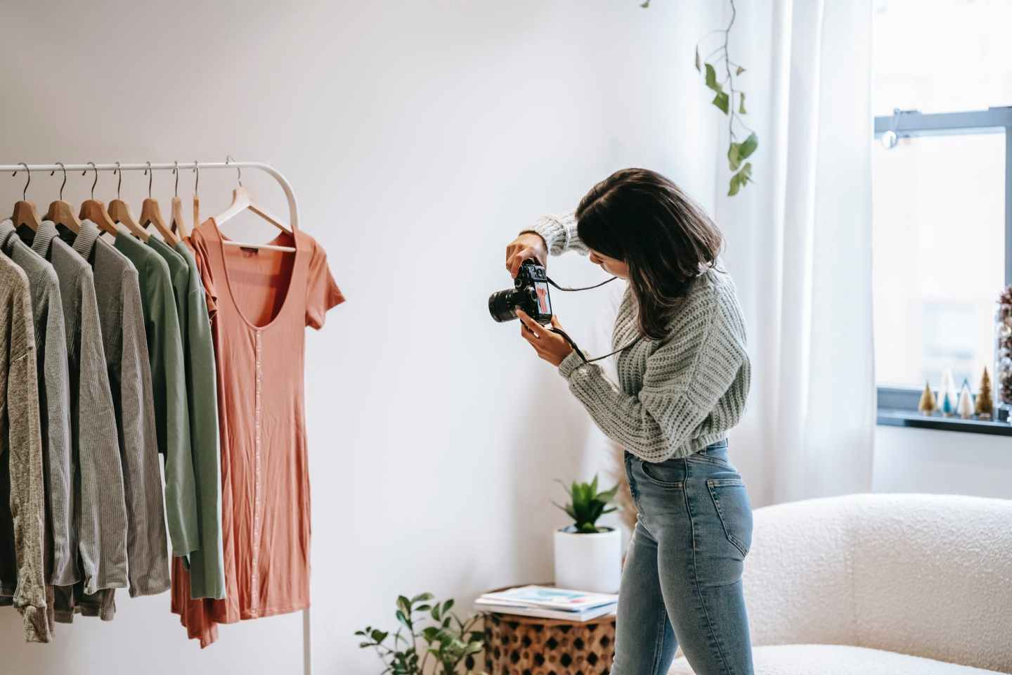 woman taking photo of clothes
