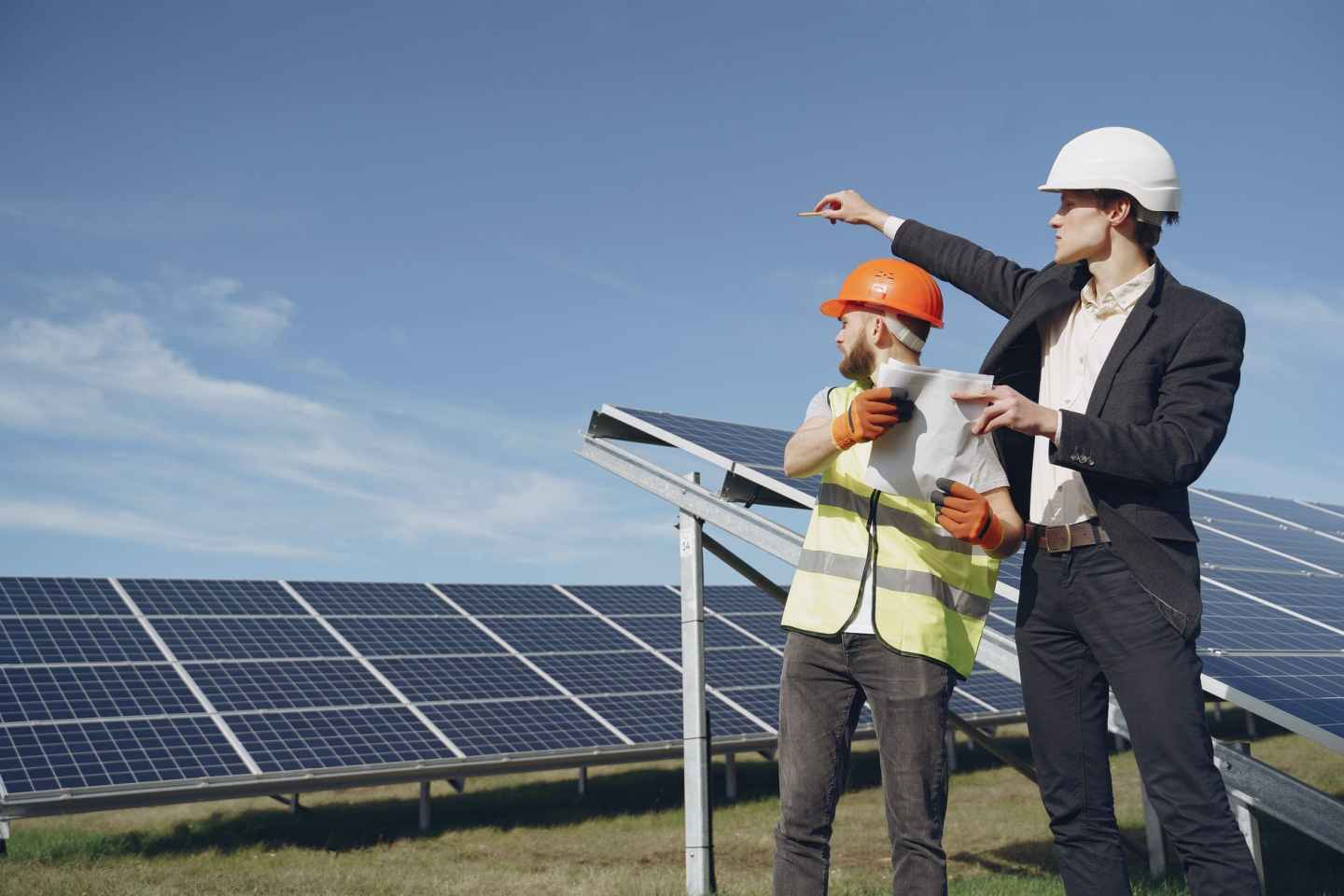 discussion of technical details of solar panels between businessman and foreman