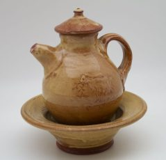 tan brown Terracotta Oil Jar on Plate by Mary Briggs