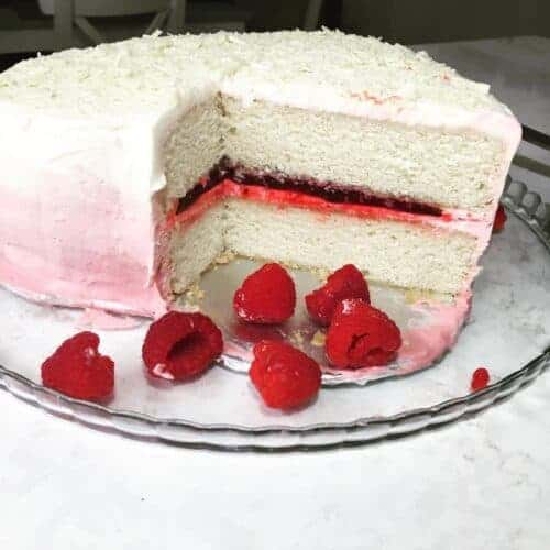 White Layer Cake with Raspberry Filling and Cream Cheese Ombre Frosting