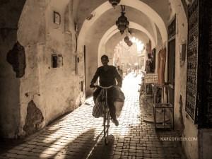 wtmk MAN ON BIKE IN PASSAGEWAY