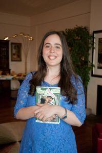 Sam holding book