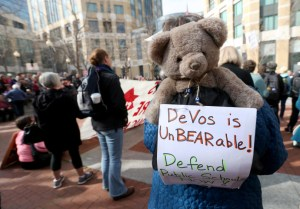 A woman wears a stuffed bear on her backpack at a noon rally at the The Ronald V. Dellums Federal Building in Oakland, Calif., on Tuesday, Jan. 31, 2017. Nearly 1,000 people denounced the appointment of Betsy DeVos as Secretary of Education after a Senate committee advanced her nomination. Statements she made in a previous hearing that protecting students from bears in rural areas could be a justification for guns in schools have led to an outcry among opponents. (Jane Tyska/Bay Area News Group)