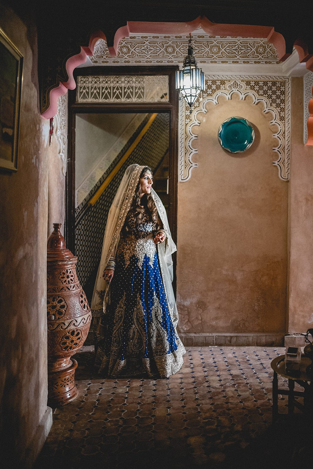 Bride looks down a traditional Moroccan path in Marrakech
