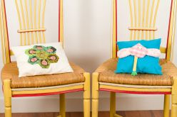 Detail. Wood chairs and patchwork cushions. 2017