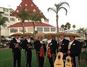 Performing At Hotel Del Corondao In Black Suits