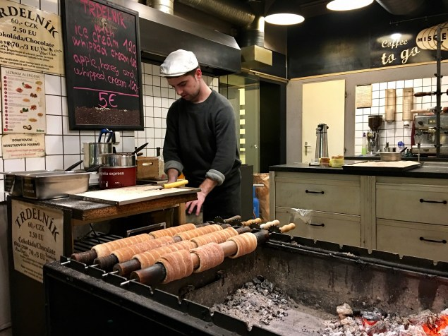 Keep warm in front of the grill as your Trdelnik is being prepared