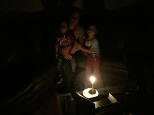 Mariangel Cabrera and her two kids during a blackout. Source: Photo provided.