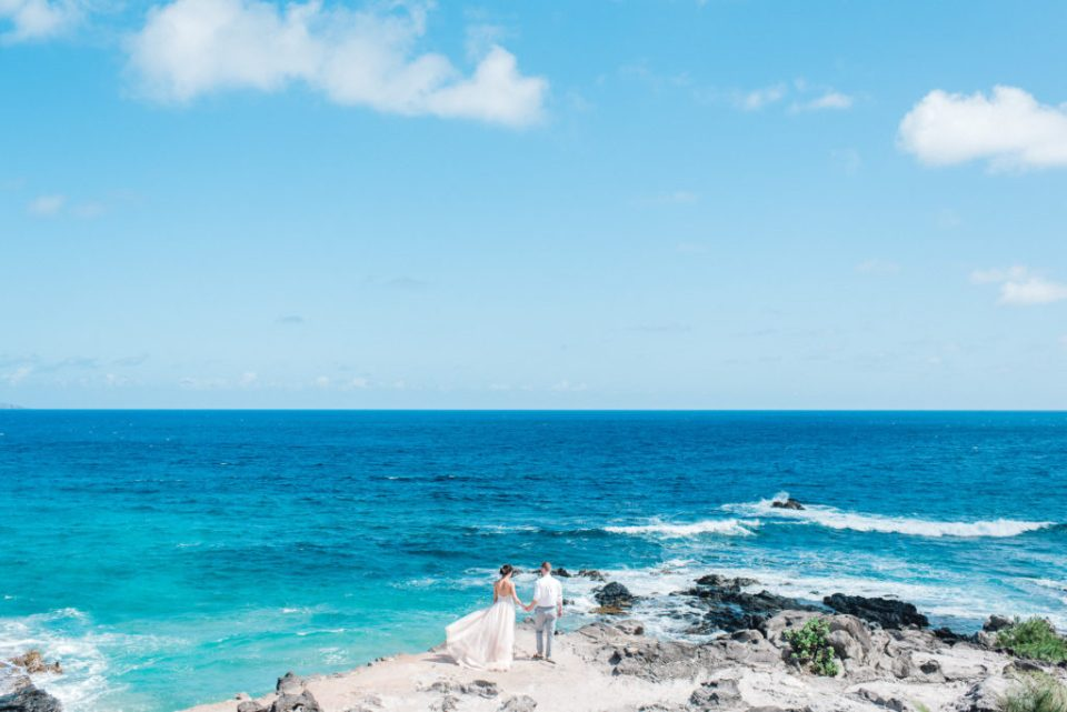 Couple elopes against a blue ocean on Maui - small wedding on cliffs