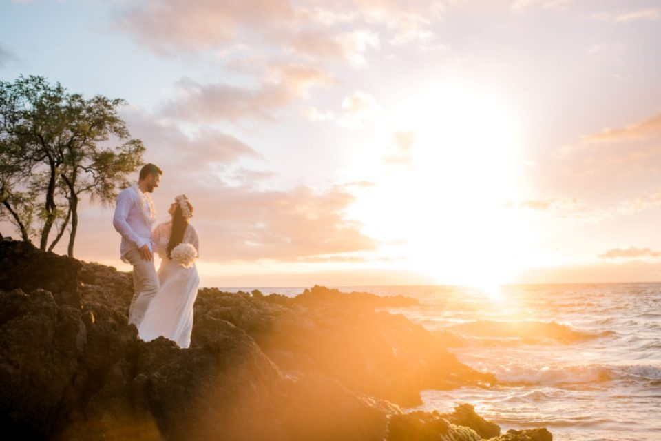 couple eloping on lava rocks at sunset on Maui