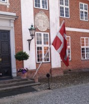Hindsgavl main entrance with a Danish flag