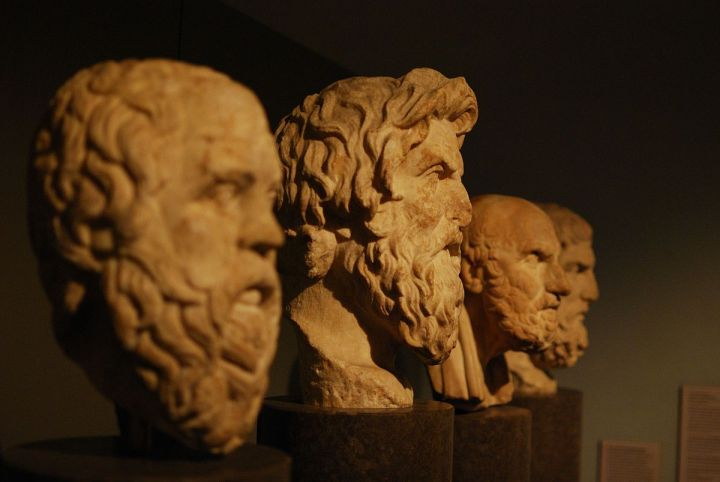 The carved busts of Socrates, Antisthenes, Chrysippus, and Epicurus.