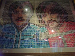 John Lennon and Paul McCartney in a poster made by stamps