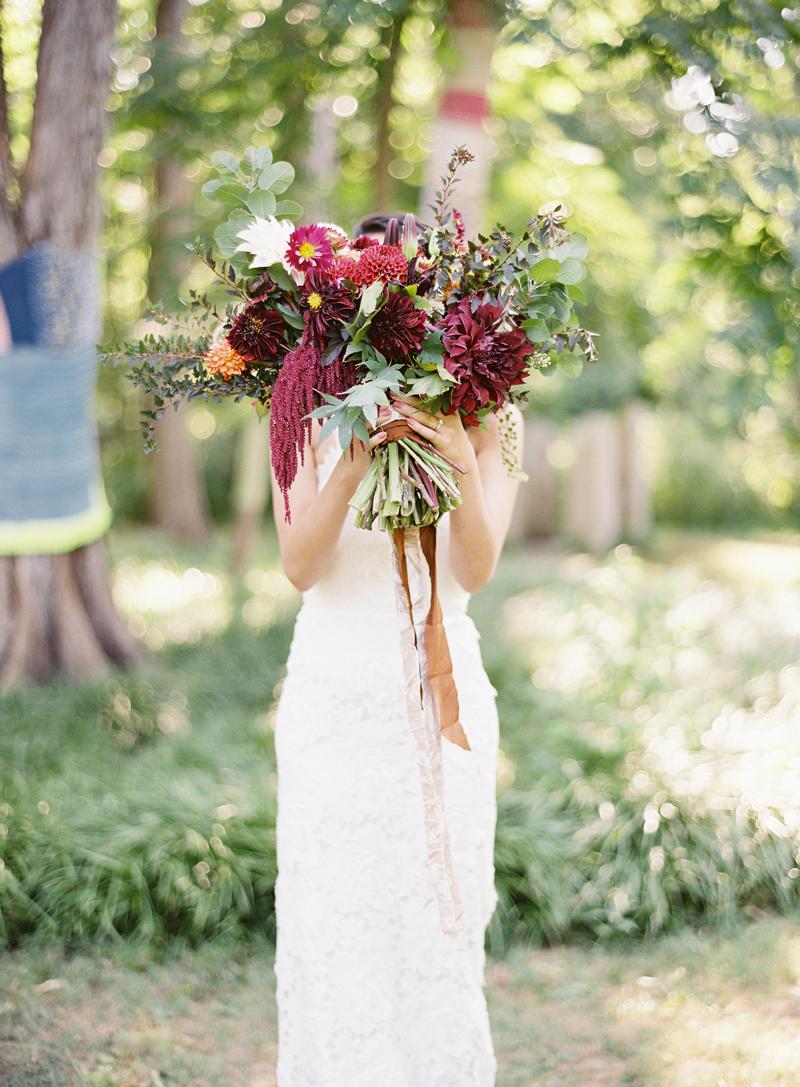 Morris Arboretum Wedding, Bride holding bright red bouquet, Chikory Florals